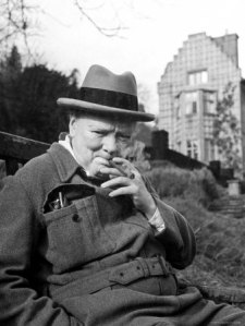 103068former-pm-winston-churchill-resting-on-bench-puffing-on-cigar-outside-country-estate-chartwell-posters2